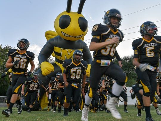 The Menard Yellowjackets burst onto the field, ready to engage the Rocksprings Angoras on their home turf, Findlay Field, September 15, 2017.