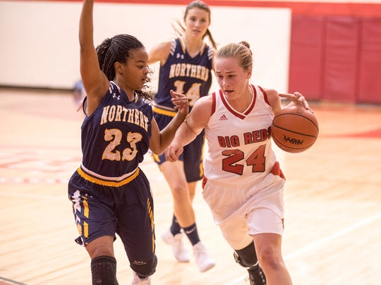 Northern's Olivia Ramsey (23) guards against Port Huron's Madeline Trombly during their basketball game at Port Huron High School Dec. 8.