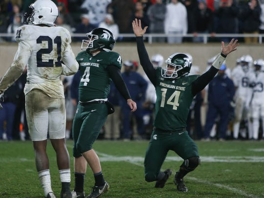 Michigan State's Matt Coghlin and Brian Lewerke react after the winning field goal for the 27-24 win against Penn State Saturday, November 4, 2017 at Spartan Stadium in East Lansing, MI.