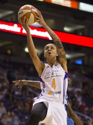 Mercury's Candice Dupree (4) goes up for a lay-up against Lynx's Tricia Liston (20) at US Airways Center in Phoenix, AZ on June 14, 2015.