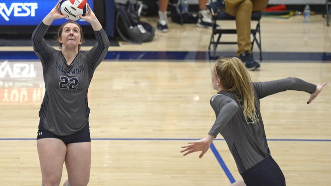Greenwood's Anna Johnson, left, sets the ball for Hannah Watkins in the second set against Sheridan during the state tournament in Greenwood on Tuesday, Oct. 27.
