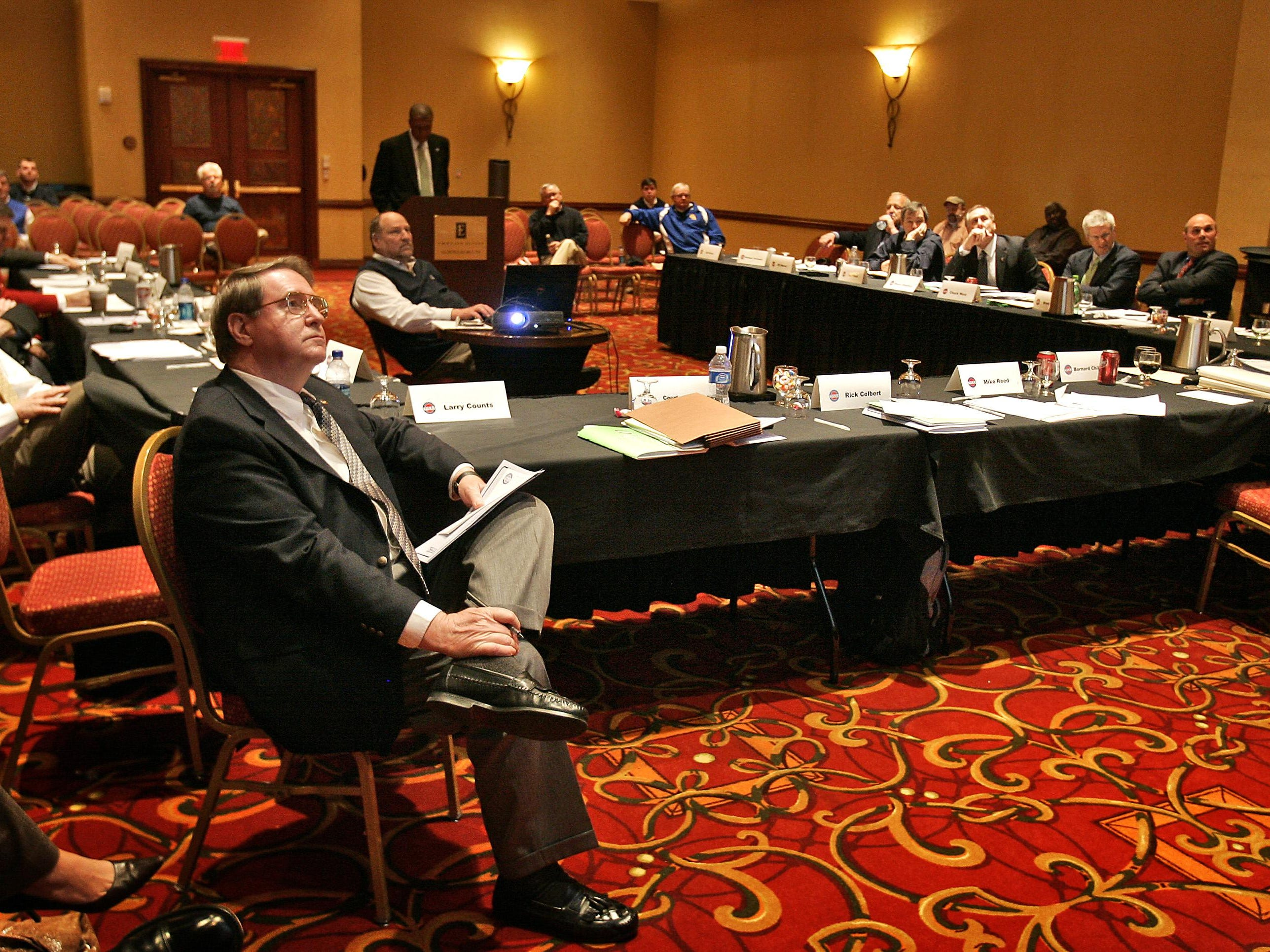 Members of the TSSAA Board of Control and coaches listen to Executive Director Bernard Childress.