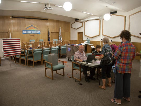 Poll workers at the Washington County Administration