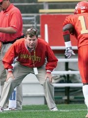 Iowa State assistant football coach Bob Elliott warms up with Marc Timmons before a game against Oklahoma State in 2001. Elliott went on to serve on Brian Kelly's staff at Notre Dame for five years. He died of cancer in July 2017.