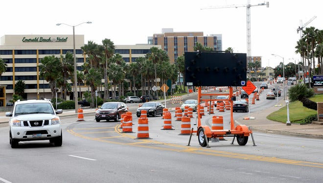 Vehicles drive by barricades as they enter Shoreline Boulevard on Friday, Dec. 30. Road work in the area is part of a plan called Bayshore Park, which was funded by $5.1 million in bonds approved by voters in 2008.