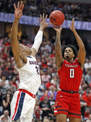 Texas Tech's Kyler Edwards (0) shoots the ball over Gonzaga's Rui Hachimura (21) during the NCAA Tournament Elite 8 game against Gonzaga, Saturday, March 30, 2019, in Anaheim, Calif.