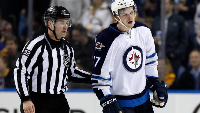 Winnipeg Jets left wing Adam Lowry (17) gets a game misconduct for boarding Buffalo Sabres right wing Patrick Kaleta during the second period.