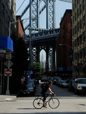 A cyclist in the DUMBO section of Brooklyn.