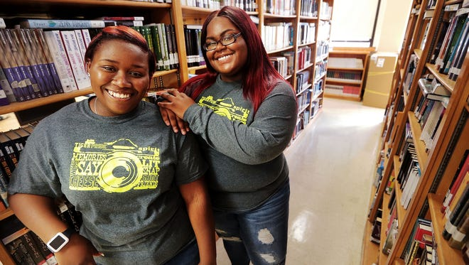 A tradition of academic achievement at Whitehaven High School continues this year, with graduating seniors Meaghen Jones, left, and Jayla Woods being offered almost $20 million in scholarships collectively from nearly 400 schools. The grads plan to attend Tennessee State University, where they will be roommates.