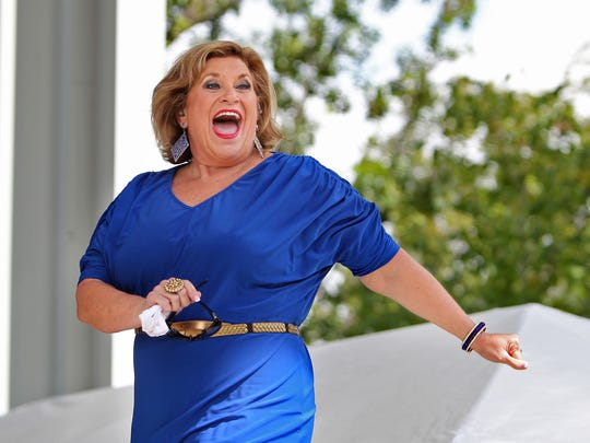Sandi Patty walks, with a huge smile, onto the Free Stage to perform at the Indiana State Fair, Aug. 14, 2012.