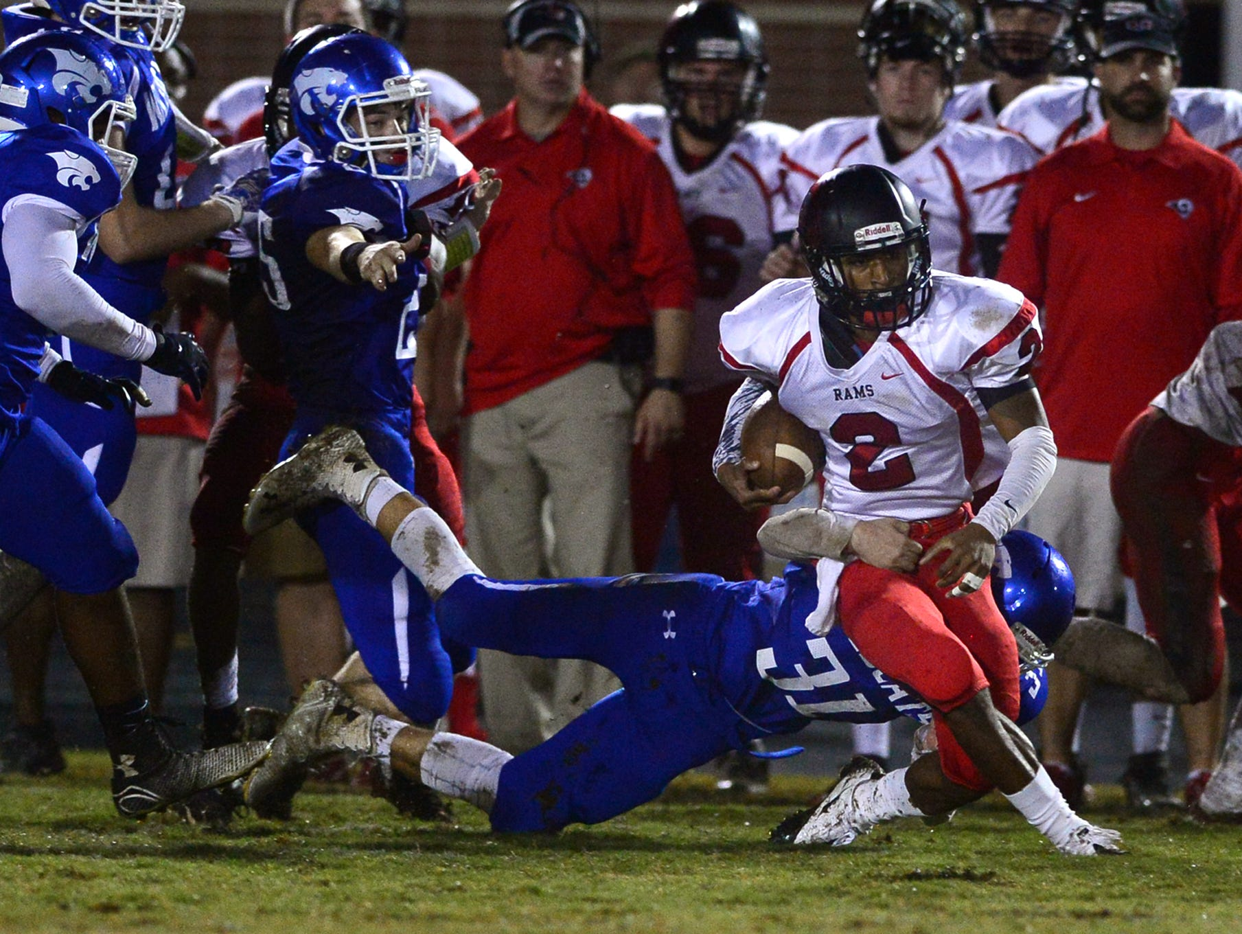 Woodmont High's Will McDougal (31) tackles Hillcrest High's Brian Spurgeon (2) at Whitt Memorial Field on Friday.