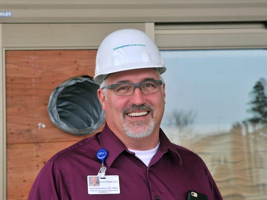 Paul Schoenberg, director of St. Cloud Hospital's emergency department, leads a tour of improvements under construction Monday, Nov. 30, in St. Cloud.