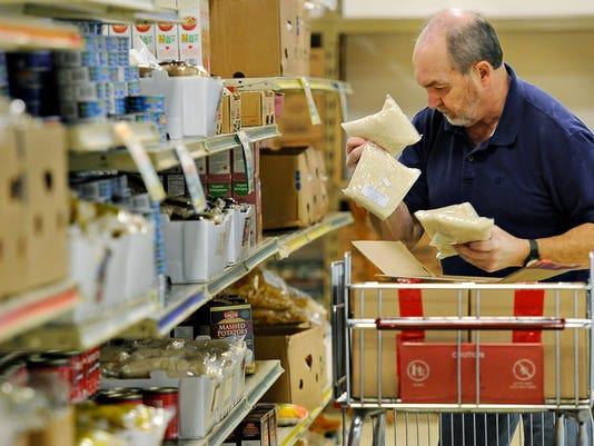 635847537827351418-Catholic-Charities-Food-Shelf.jpg