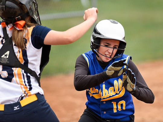 Kimball's Mackenzie Leither  dives under the tag at home to score against Howard Lake-Waverly-Winsted in the second inning Monday at Kimball High School.