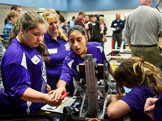 Competitors in the Hex robot competition make final adjustments to their robot during the Tri-Rivers Career Center's Manufacturing day on Thursday.