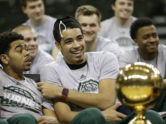 In middle, UW-Green Bay's Jordan Fouse is all smiles as he sits with teammate Carrington Love during a selection show watch party at the Kress Events Center in Green Bay in March.