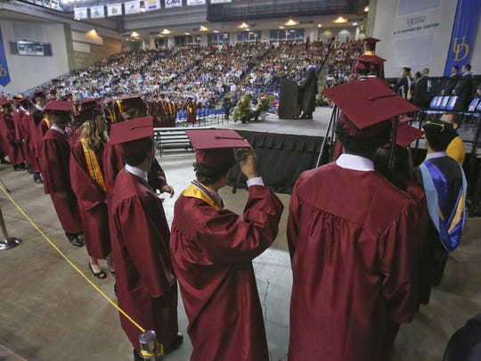 About 350 students are graduated from Appoquinimink High School at the Bob Carpenter Center Tuesday. Administrators say the practice of doing exit interviews with students who are threatening to drop out has decreased the district's dropout rate.