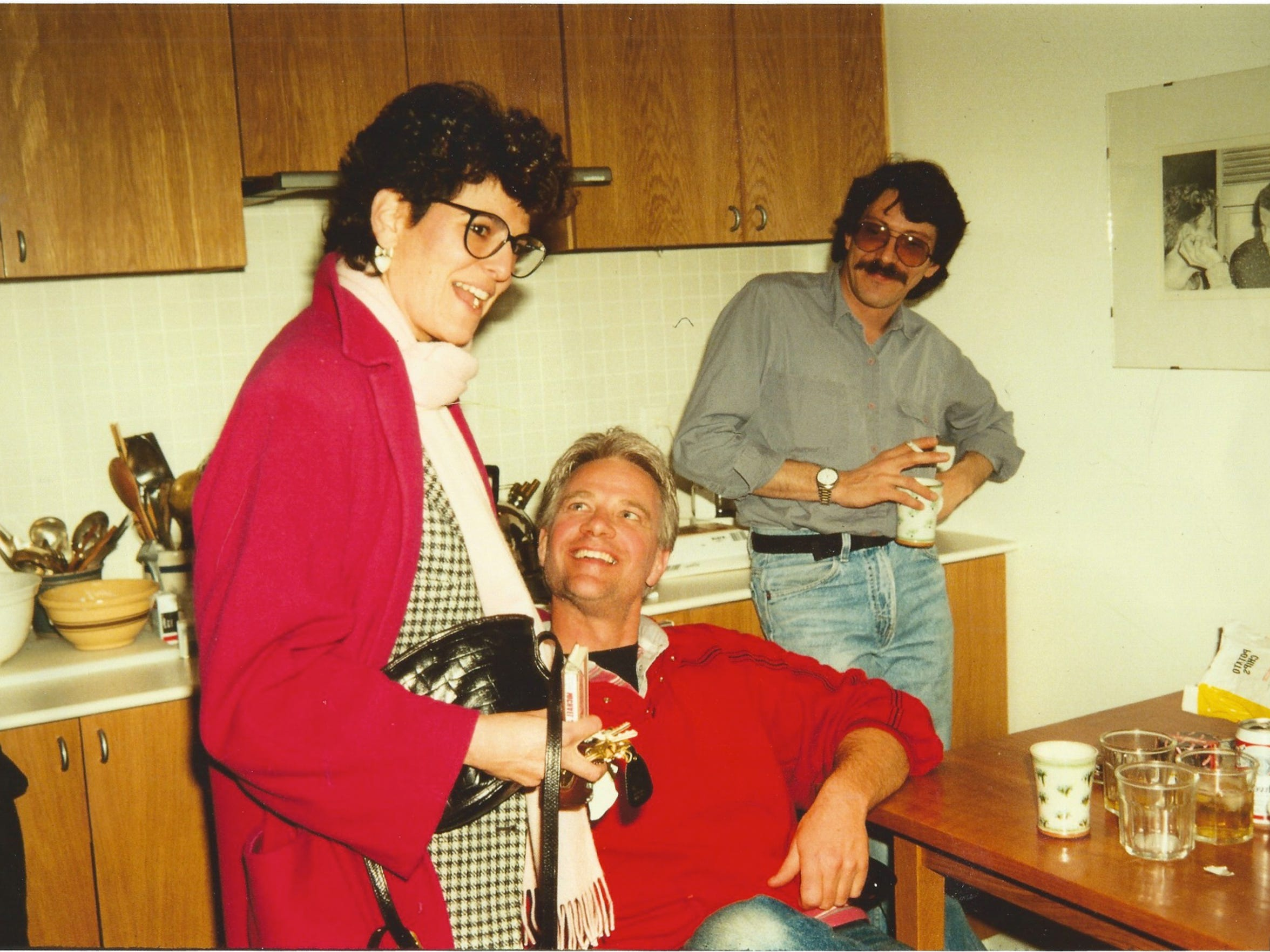 "Rabbi Lynne Landsberg, Dennis Ward and Jeff Felcher in friend Wendy Wray's apartment in Staunton in the mid '80s. ""Dennis was looking at her and couldn't believe that someone would iron her jeans,"" said Wray, remembering how everyone would hang out in her kitchen when she would have people over her home. Ward and Landsberg began dating and married two years later."
