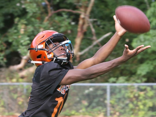 Central Kitsap's Elijah McGee will try to make the transition from wide receiver to quarterback this spring as the Cougars prepare of the 2018 season. Football teams are allowed up to 20 practices during the spring football period.