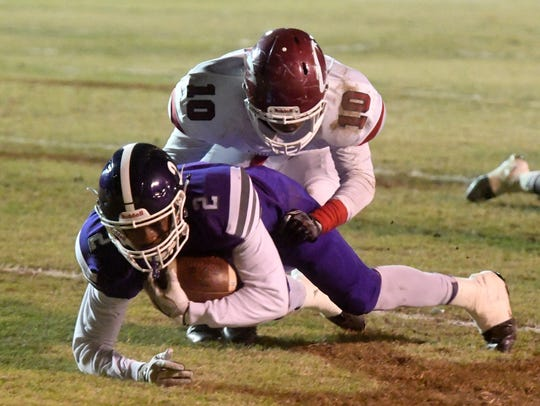 Haywood's Deyondrius Hines is tackled from behind by