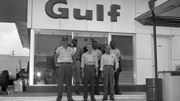 Gas stations used to feature a full crew of attendants, such as this Gulf location in Tallahassee during the '60s.