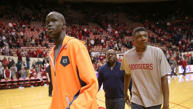 Indiana Basketball recruits Thon Maker,left, and Thomas Bryant,right, walk off the Hoosiers court Saturday, March 7, 2015, afternoon at Assembly Hall in Bloomington IN. The Spartans defeated the Hoosiers 74-72.
