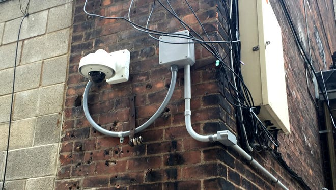 A Bedrock Real Estate Services security camera that is mounted at the rear of the Detroit Beer Co on Broadway facing an alley in downtown Detroit. Photo taken Monday April 27, 2015.