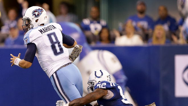 Indianapolis Colts inside linebacker D'Qwell Jackson (52) sacks Tennessee Titans quarterback Marcus Mariota (8) in the second half of  their NFL football game Sunday, November 20, 206, afternoon at Lucas Oil Stadium. The Colts defeated the Titans 24-17.