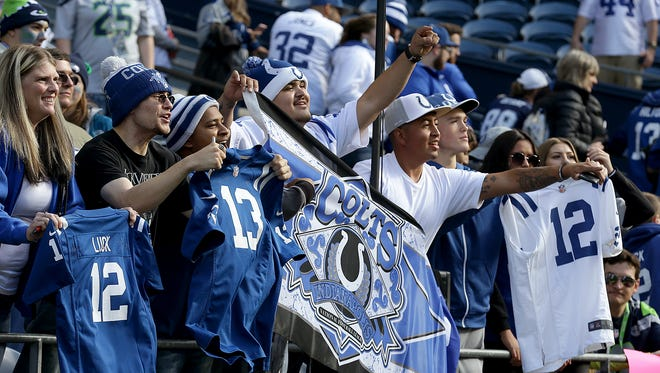 Indianapolis Colts fans watch the team warm up before the start of their game at CentryLink Field in Seattle Sunday, Oct 1, 2017.
