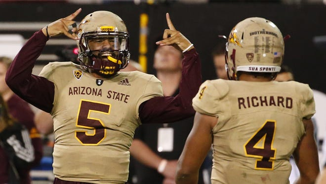 Arizona State Sun Devils quarterback Manny Wilkins (5) celebrates his touchdown with teammate running back Demario Richard (4) during an football game against the Colorado Buffaloes at Sun Devil Stadium in Tempe on November 4, 2017.