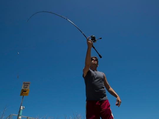 "Cape Coral resident Josh Lowman casts his fishing line at Sirenia Vista Park in Cape Coral on Monday, April 16. ""I try to come out here as often as possible,"" said the local angler."