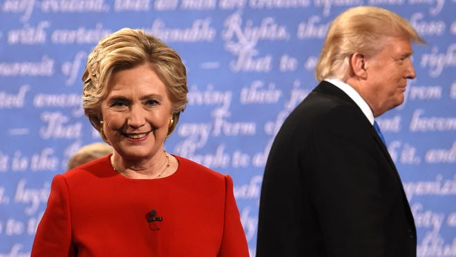 This Sept. 26, 2016, file photo shows Hillary Clinton and Donald Trump leaving the stage after the first presidential debate at Hofstra University in Hempstead, N.Y.