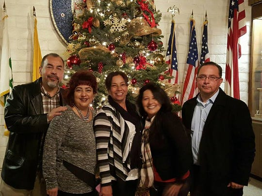 Staff from Homeless Solutions at Christmas party from left to right:  Rodrigo Torres, Dir. of Operations; Janie Ayala, Admin Assistant; Susan Guzman, Case Mgr.;  Yolanda Talamente, Case Mgr.; Reyes Bonilla, Executive Director.