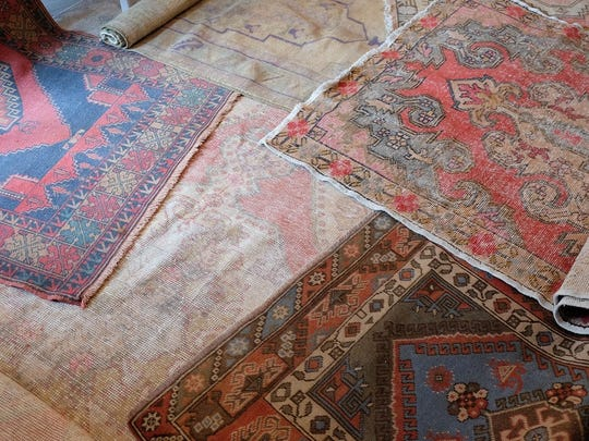 Vintage Turkish, hand-knotted rugs in a mixture of faded pastels and vibrant colors. Created on traditional looms, the rugs do not typically come in large sizes. Great for small areas, or layer multiples to create a beautiful bohemian look. Average price: $500-700.