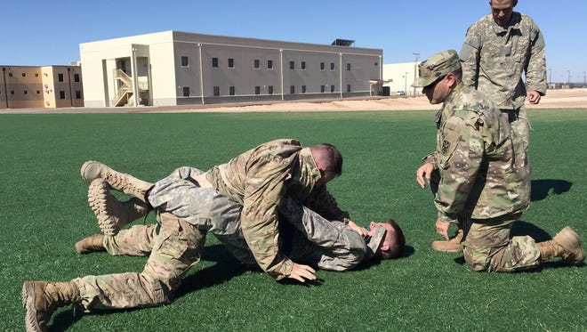 Soldiers compete in combatives during the Blackjack Warrior Week competition at Fort Bliss.