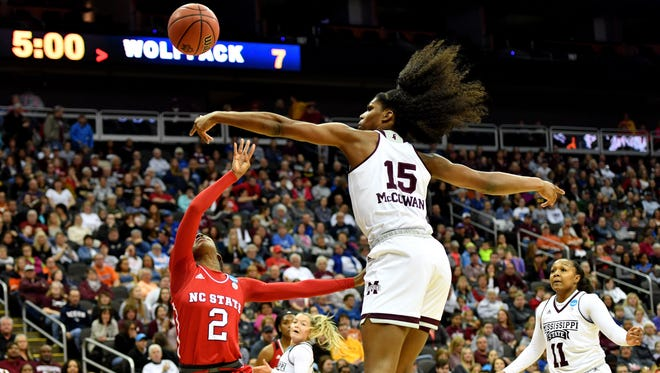 Mar 23, 2018; Kansas City, MO, United States; North Carolina State Wolfpack guard Kaila Ealey (2) has her shot blocked by Mississippi State Lady Bulldogs center Teaira McCowan (15) in the semifinals of the Kansas City regional of the women's basketball 2018 NCAA Tournament at Sprint Center. Mandatory Credit: Denny Medley-USA TODAY Sports