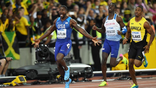 LONDON, ENGLAND - AUGUST 05:  Justin Gatlin of the United States raises his arms as he crosses the line to win the Men's 100 metres final in 9.92 seconds during day two of the 16th IAAF World Athletics Championships London 2017 at The London Stadium on August 5, 2017 in London, United Kingdom.  (Photo by Shaun Botterill/Getty Images)