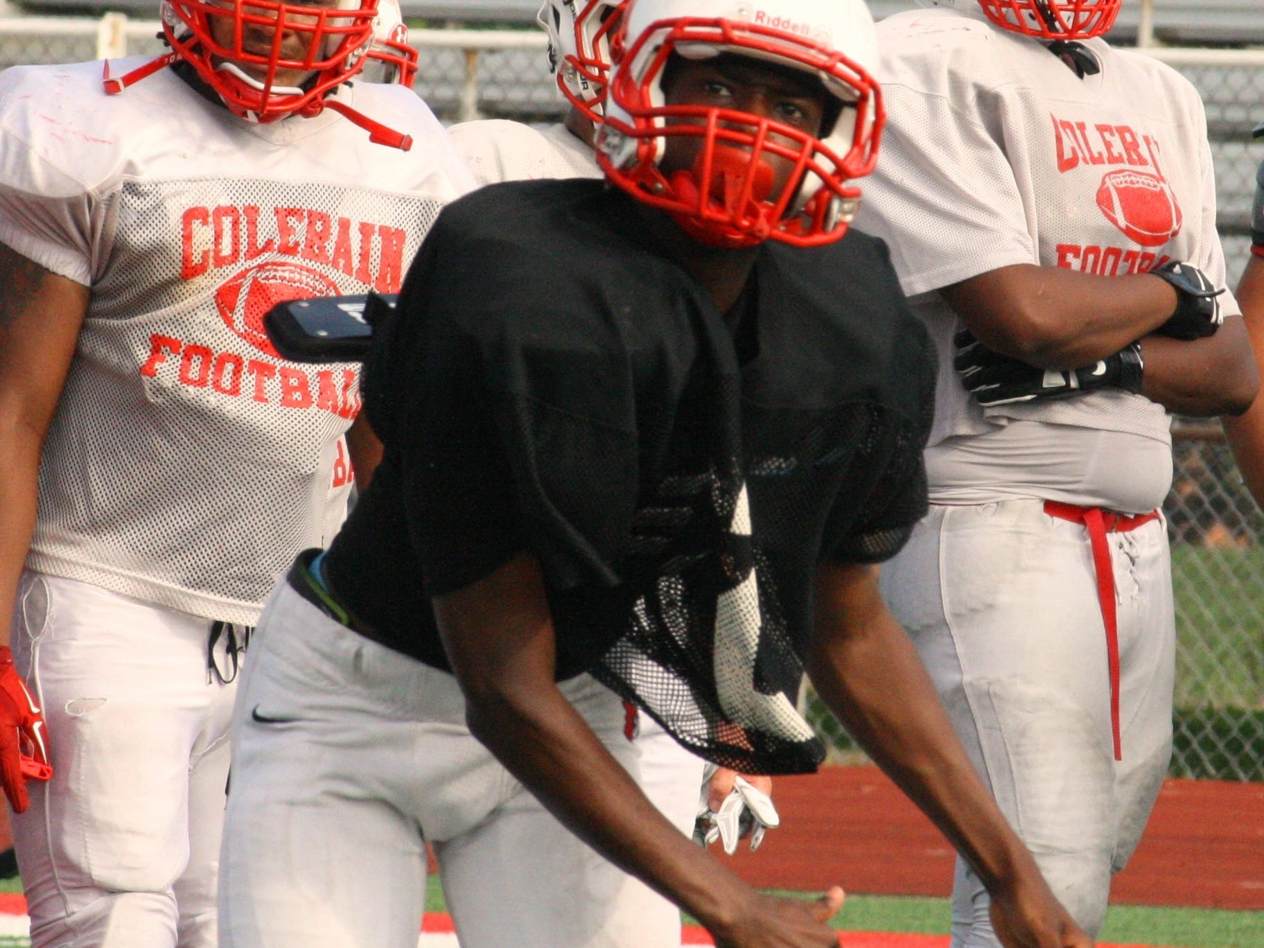 Colerain High School junior Dashaunte Jones follows through on a pass during practice Aug. 19. Jones is competing with senior Spencer Henn for the starting quarterback position.