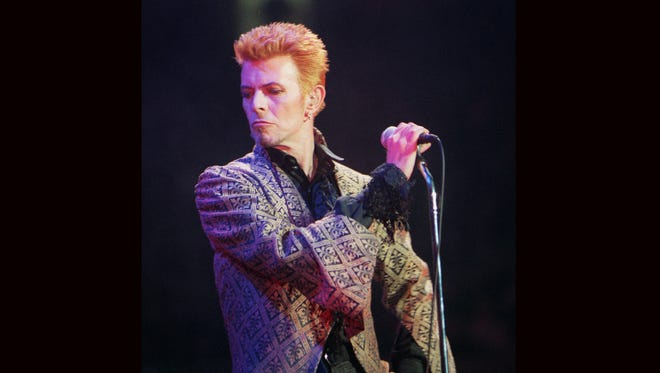 David Bowie performs during a Jan. 9, 1997, concert celebrating his 50th birthday, at Madison Square Garden in New York. Bowie, the innovative and iconic singer whose illustrious career lasted five decades, died Monday, Jan. 11, 2016, after battling cancer for 18 months. He was 69.
