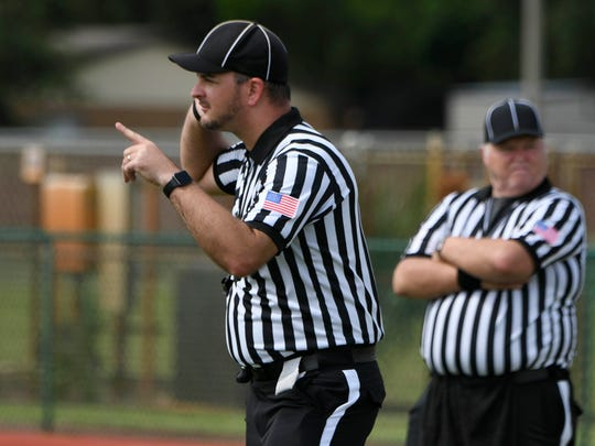 Doug McAlister listens to one of the other field officials during Saturday's scrimmage. Players from Astronaut, MCC, Holy Trinity and Eau Gallie scrimmaged as members of the Mid Coast Officials Association conducted a field clinic at Astronaut High School.