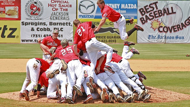 Austin Peay baseball team members celebrate winning the 2012 OVC tournament and earning the conference's bid to the NCAA Regional.