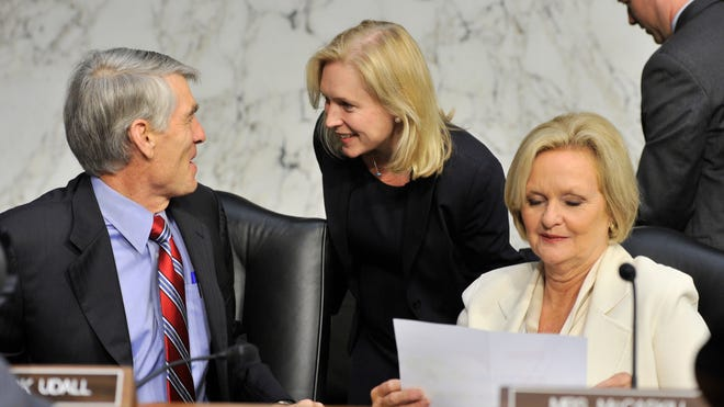 Sens. Kirsten Gillibrand, center, and Claire McCaskill, right, have rival proposals to change how the military handles sexual assaults.