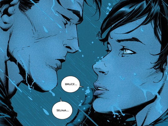 Bruce Wayne and Selina Kyle share an intimate moment