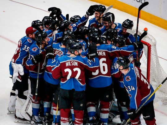 The Colorado Avalanche celebrate following an NHL hockey game against the St. Louis Blues on Saturday, April 7, 2018, in Denver. Colorado won 5-2 to advance to the playoffs. (AP Photo/Jack Dempsey)