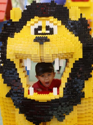 A boy poses inside a mouth of a LEGO lion during a preview at LEGOLAND Malaysia in Nusajaya, Johor, southern Malaysia, Saturday, Sept. 1, 2012. Construction will begin this summer on a LEGOLAND Discovery Center Michigan at Great Lakes Crossing Outlets.