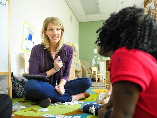 Teacher Angela Brown works with KaMaya Butler in her pre-K class at Ross Early Learning Center in Nashville.
