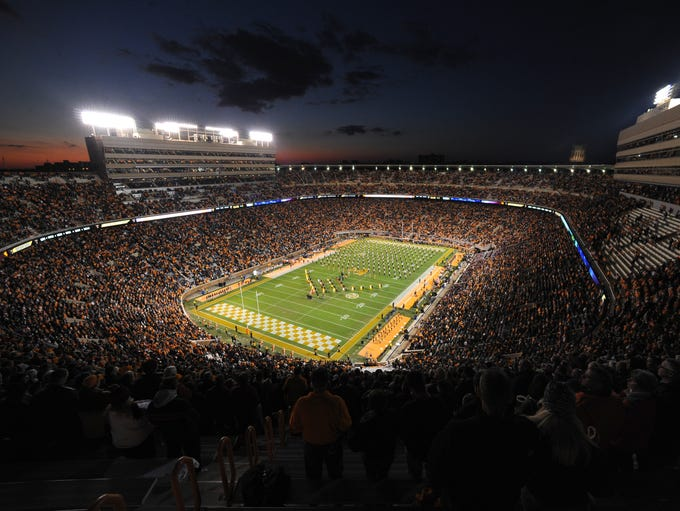 The sun sets to the west Neyland Stadium while the