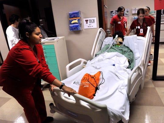 Texas Tech nursing students wheel a mannequin in a bed during an exercise Nov. 14.  Texas Tech's presence in Abilene was among one of the largest projects funded in part by the Dodge Jones Foundation.