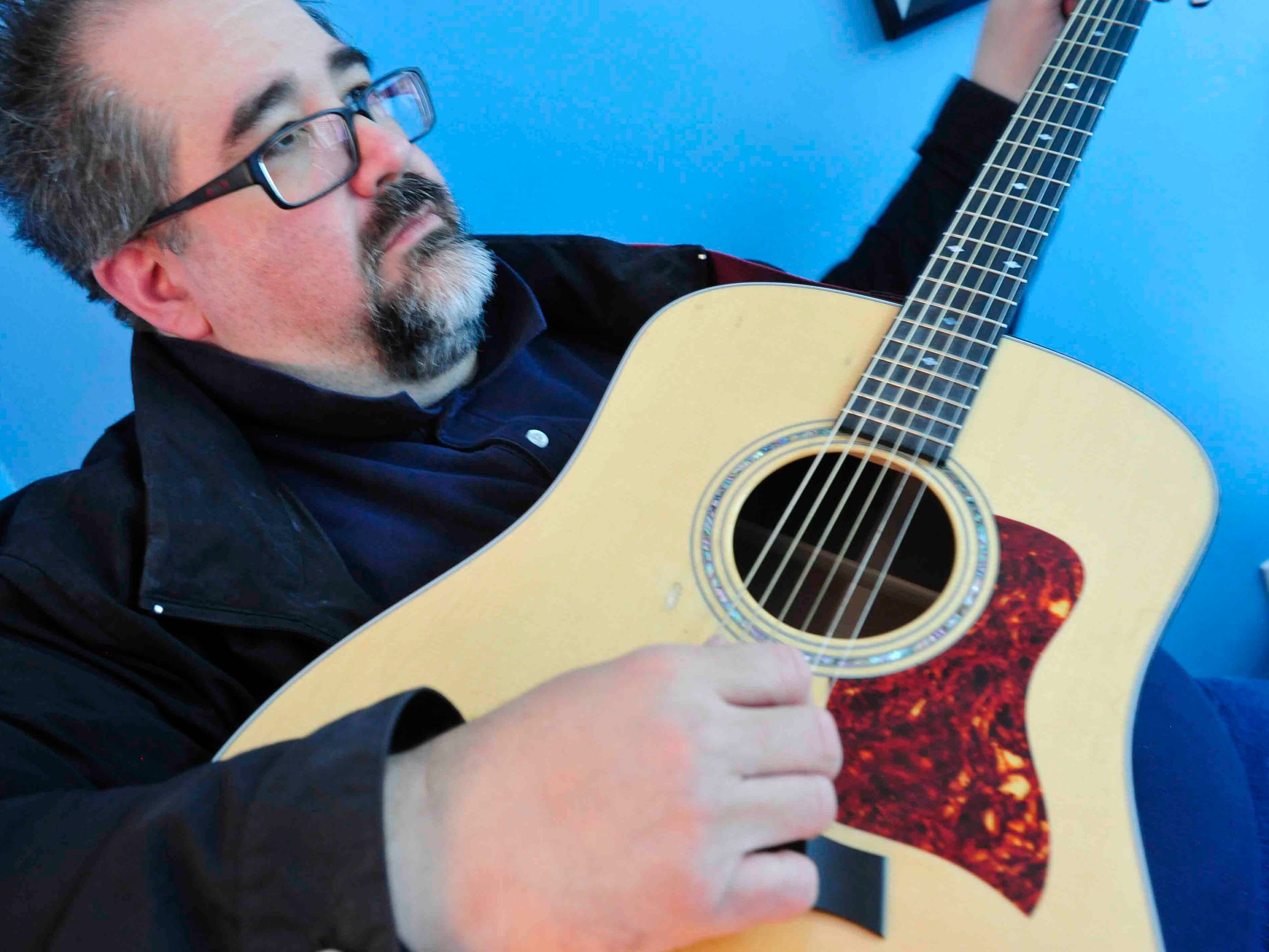 Jim Reilley, co-founder of the New Dylans, works on songwriting at his Berry Hill writing studio.