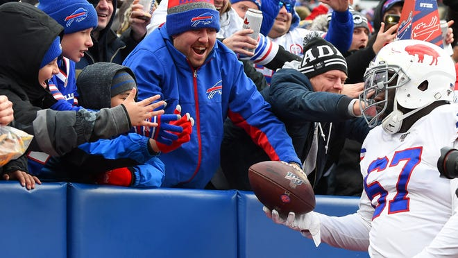 Nov 3, 2019; Orchard Park, NY, USA; Buffalo Bills offensive guard Quinton Spain (67) hands the game ball to a fan against the Washington Redskins during the fourth quarter at New Era Field. Mandatory Credit: Rich Barnes-USA TODAY Sports